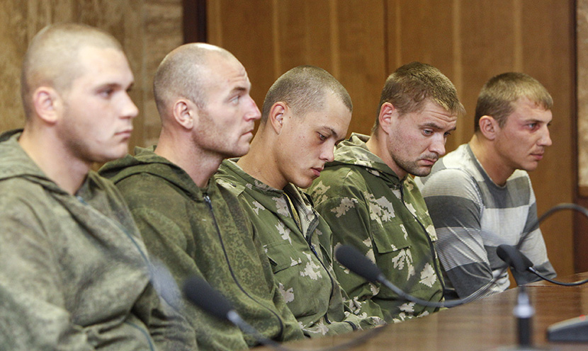 A group of Russian servicemen, who are detained by Ukrainian authorities, attend a news conference in Kiev