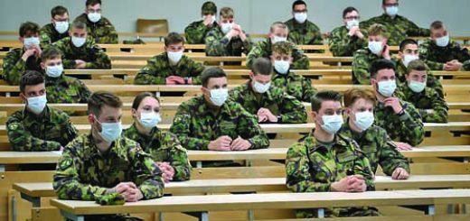 Swiss soldiers wearing protective facemasks gather in a classroom, on April 30, 2020, at the Swiss army barracks of Chamblon, in order to install on their smartphone, for field tests, an app created by the Swiss Federal Institute of Technology Lausanne (EPFL) that could help trace those who have been in close contact with someone who tested positive for the COVID-19 caused by the novel coronavirus. - A unit of Swiss army conscripts are taking the fight to the coronavirus pandemic by helping to develop a Bluetooth-based smartphone app aimed at suppressing a resurgence of COVID-19. (Photo by FABRICE COFFRINI / AFP)